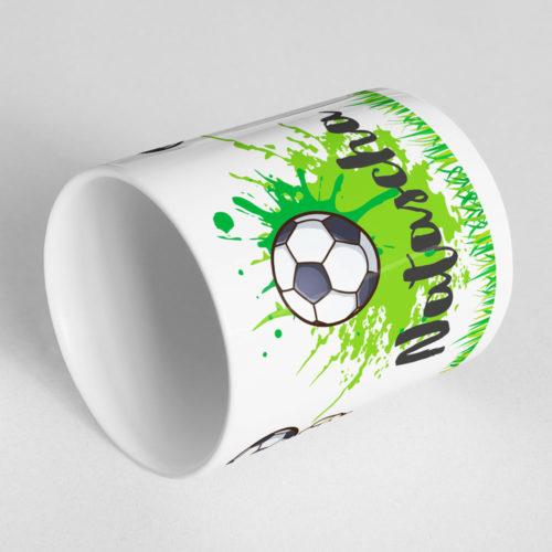 Mädchen Torwart Tasse mit drehbarem Fußball am Henkel Ansicht liegend